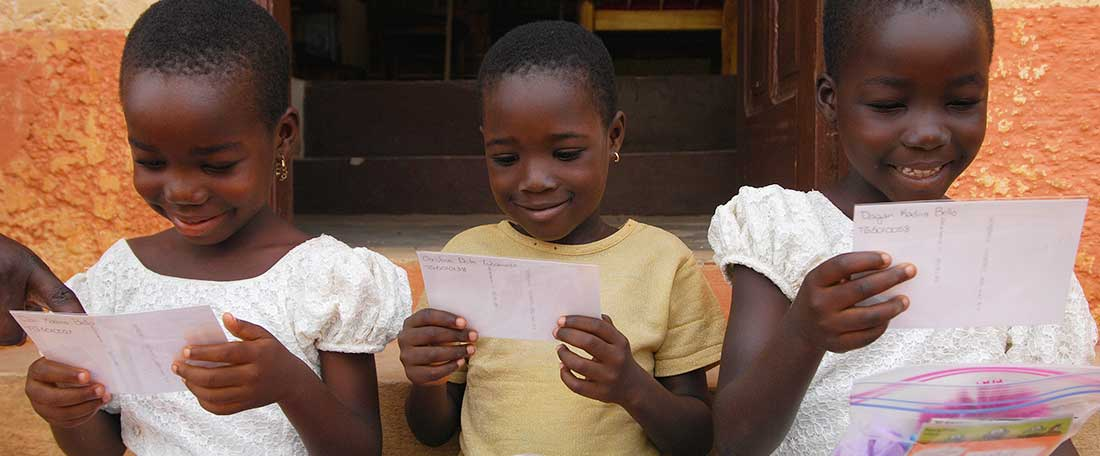 Girls reading letters in Togo