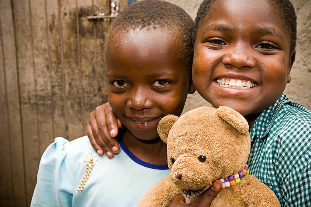 Sisters with a teddy bear